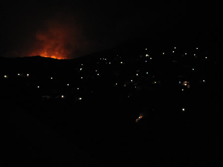 Night fires in Mandraki seen from Kamini
