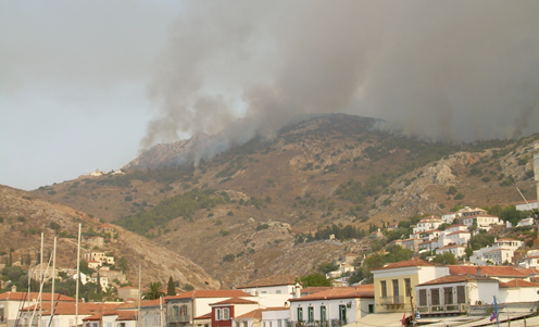 Fire encroaches upon Hydra town