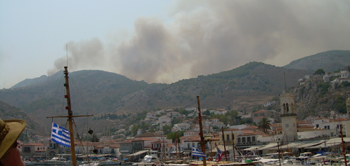 Fire raging behind Hydra town